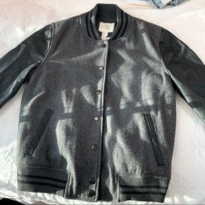 Juniors' woman's black varsity jacket